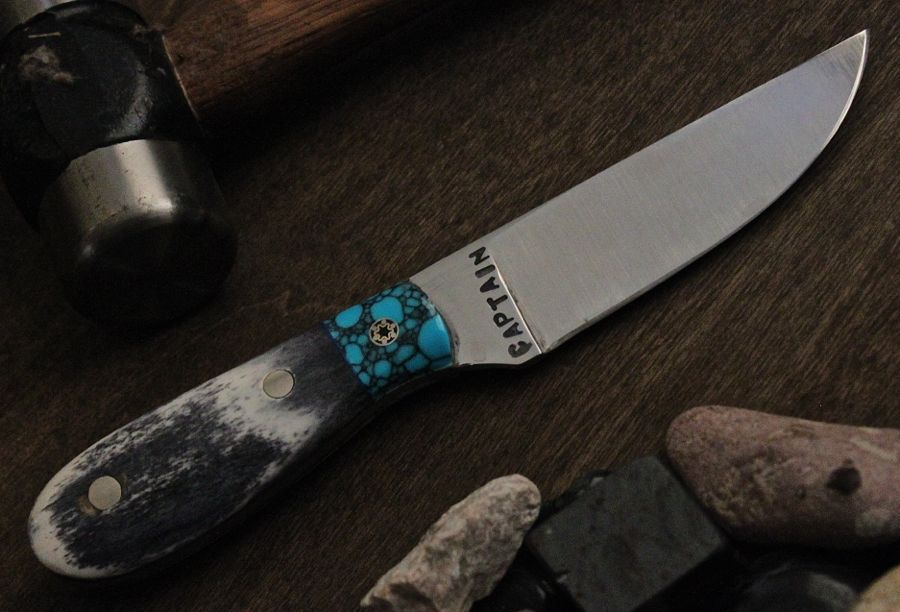 Custom hunter Black camel bone with turquoise bolster, made in 1084 steel.