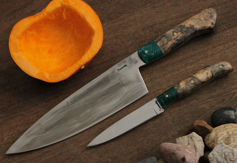 Matching Chef and Paring knives in 12C27 stainless steel with malachite bolster and Black Ash Burl handles.