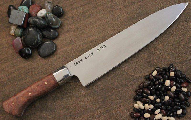 I finally finished the Landry's Iron Chef Companion knife. This is a copy of the knife Landry's gave away to the Chef that wins their throw down Competition.