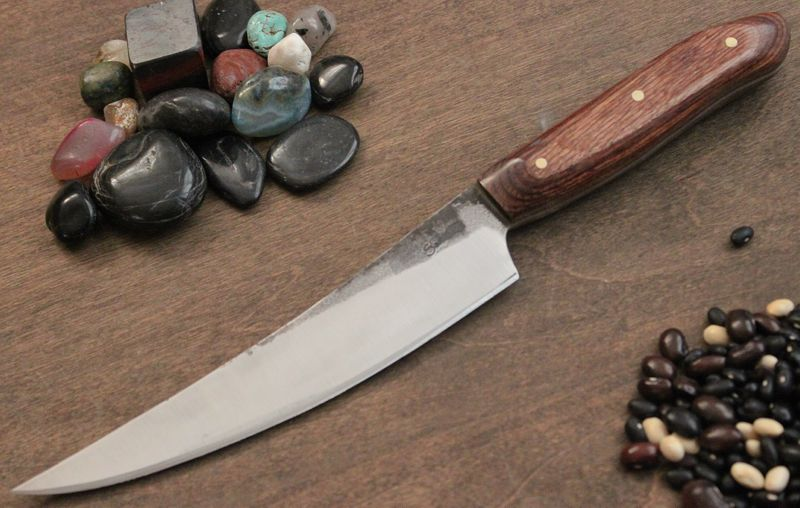 "A boning knife with Dymondwood handle and 3 - 1/8"" Brass pins"
