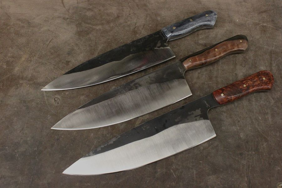 3 European Chef Knives, handles top to bottom: Grey Camel Bone, East Asia Ebony, Dark Cherry Burl.