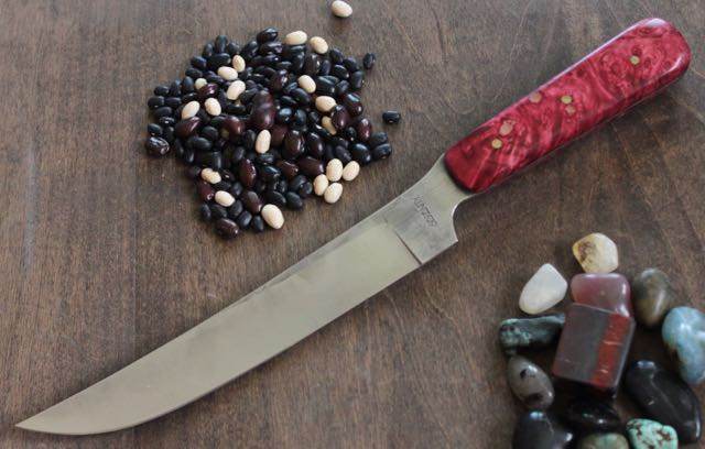 "8 1/4"" Boning knife in 52100 High Carbon steel full tang blade made with a Stabilized and Pink Dyed Maple burl handle, with 3 - 1/8"" brass pins. Measures 1 1/4"" deep at the heel, 3/32"" thick at the spine. Handle is 4 5/8"" long, 3/4"" wide and 1 1/8"" at its deepest."