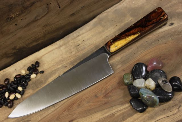"Gyuto: Kiritsuki tip with rectangular shaped handle in  CPM154 Stainless blade, Natural Ironwood handle. Buffed Forge Finish on the blade. 6 - 3/32"" brass pins. Custom Kydex knife transporter is included.              Blade Length: 8""                                         Handle Length: 4 3/4""              Overall Length: 12 1/2""              Blade Depth: 2""                                           Blade Thickness: .143"""
