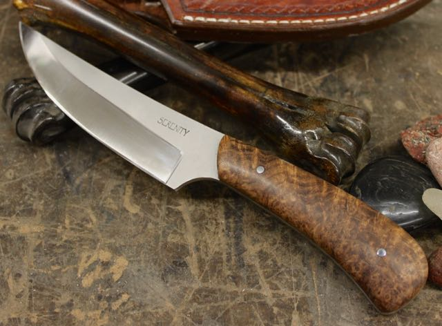 "Upswept Utility/Hunter  CPM 154 Stainless Steel blade with Acid blast ricasso, shiny primary grind Finish, stabilized Mesquite Burl handle, 2 - 1/8"" nickel silver pins. Comes with hand tooled brown leather sheath."