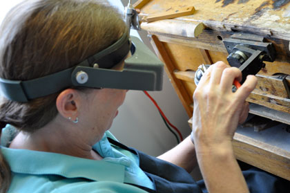 Master Jeweler working away. She has decades of experience repairing jewelry you have.