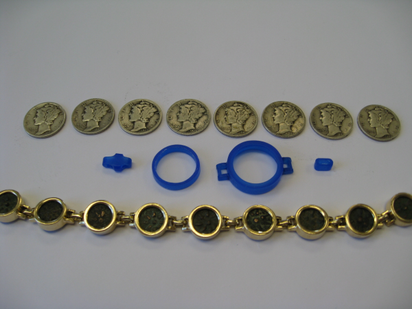 Final bracelet with mold and coins
