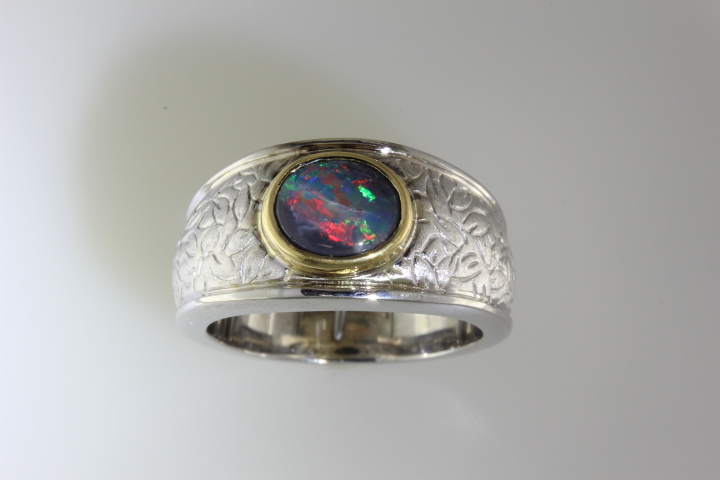 Top view of magnificent black opal ring