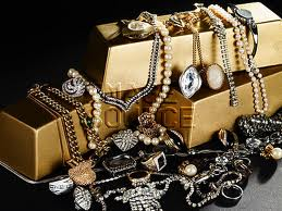 gold bars and jewelry.jpg