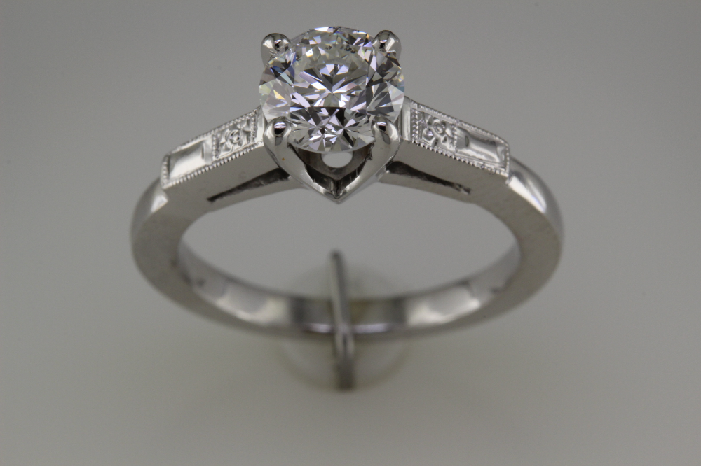White gold restored engagement ring with 1.00 carat round brilliant center diamond.