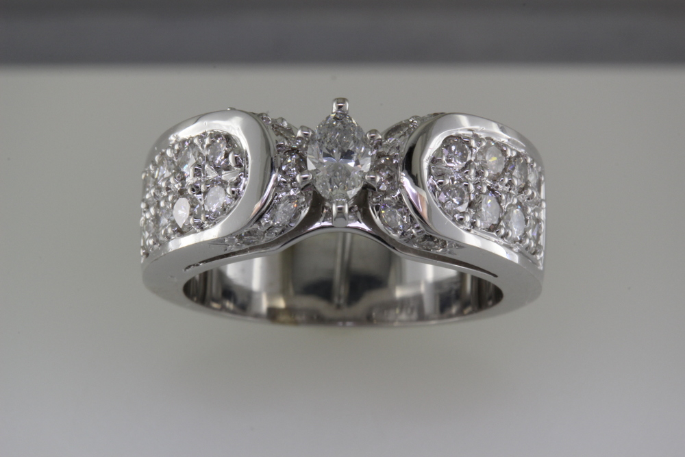 Crafted ring using customer's diamonds.