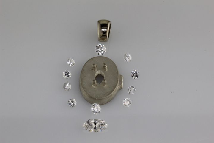 Cast pendant and diamonds