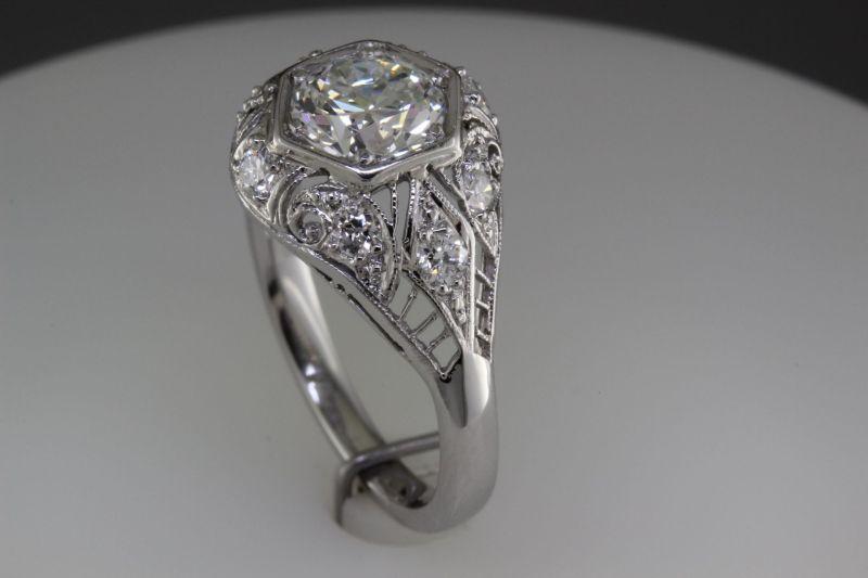 Platinum antique ring with 1.25 carat diamond.