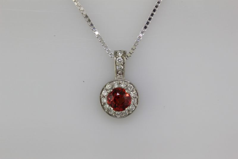 Red sapphire and diamond pendant