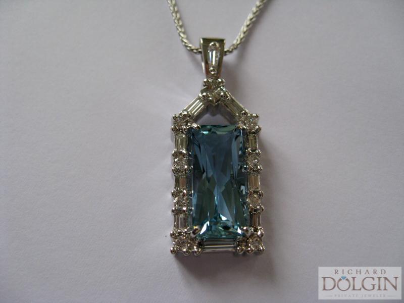 Finished aquamarine and diamond pendant