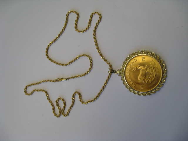 Pendant with gold piece