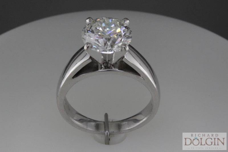Round cathedral engagement ring