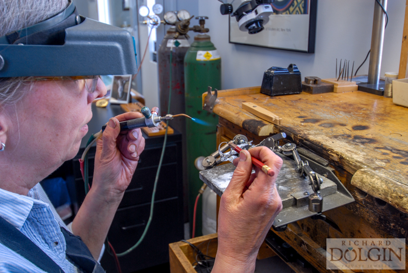 Soldering in the jewelry shop at Richard Dolgin Private Jeweler