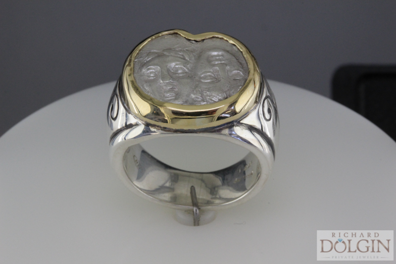 18k gold bezel and silver ring