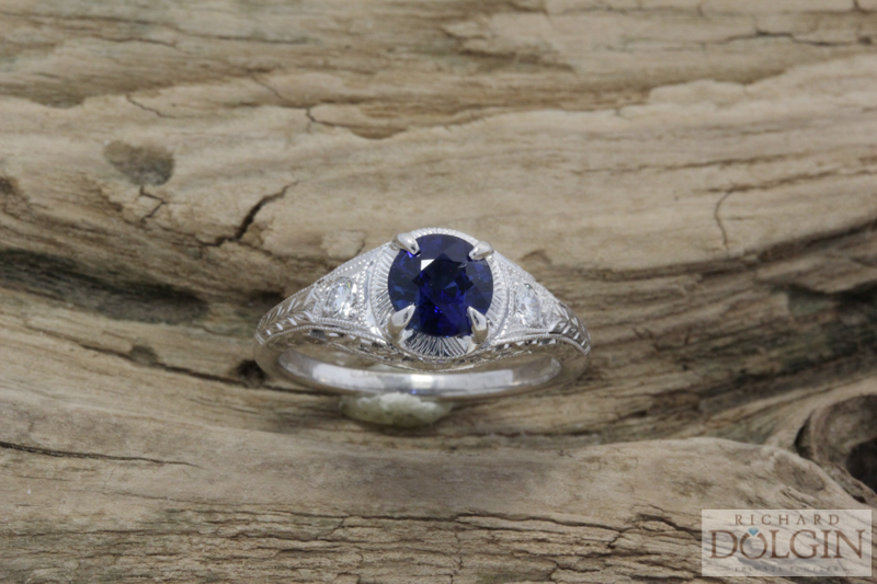 Hand engraved sapphire and diamond ring