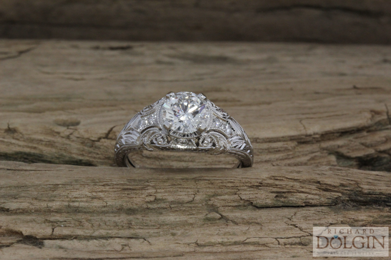 Hand engraved platinum and diamond ring
