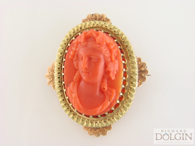 Carved cameo pin