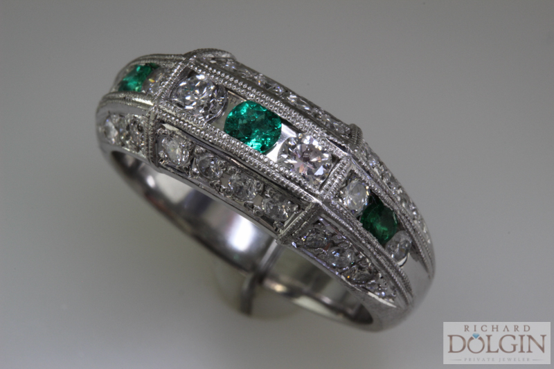 Emerald and diamond platinum ring