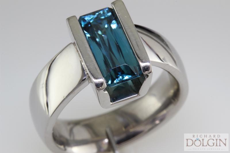 Emerald scissor cut blue zircon ring