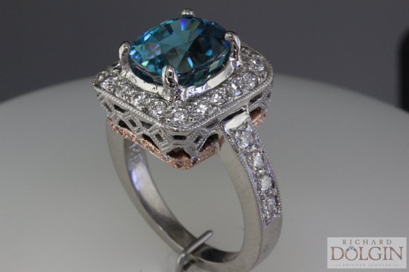 Blue zircon and rose gold and palladium ring