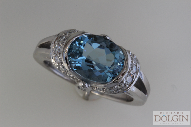 Cushion cut blue zircon and diamond ring