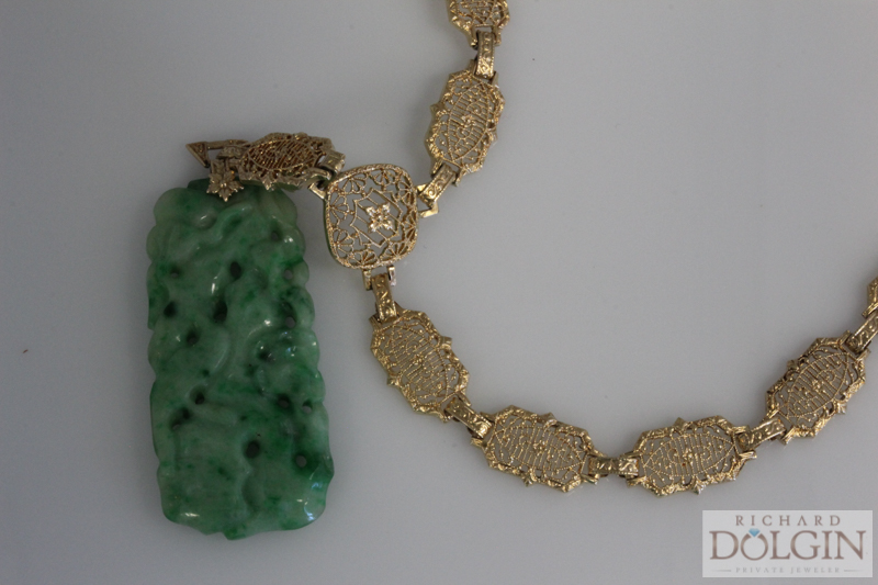 Two sided carvings on jade and gold necklace