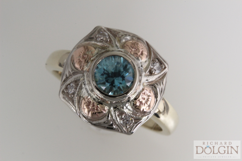 Center blue zircon accented with diamonds