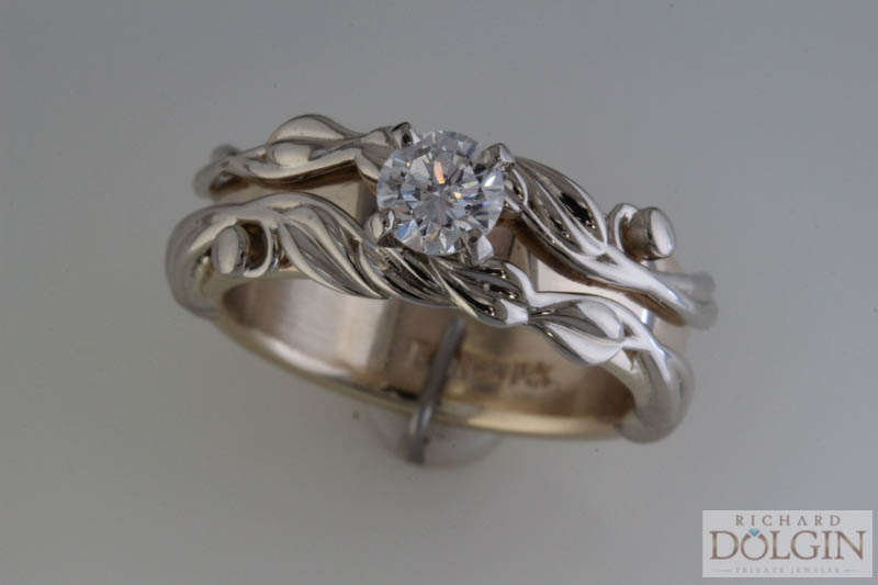 Floral band accenting center diamond