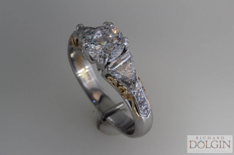 Two tone engagement ring with trilliants