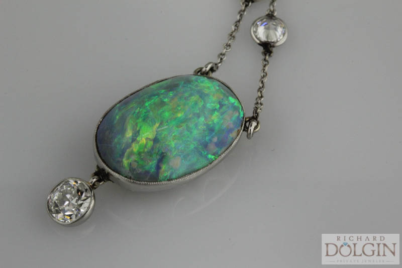 Black opal pendant on a diamond station necklace