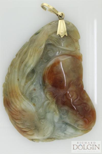 Antique carved jade pendant