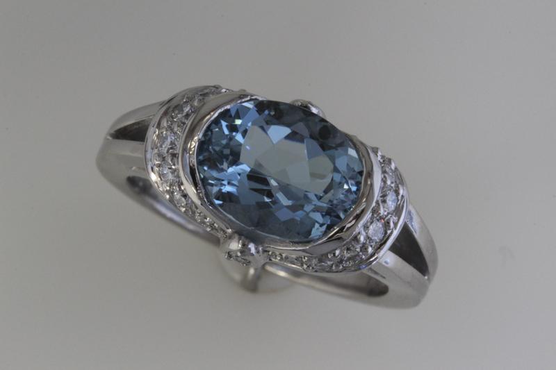 Blue zircon and diamond ring.