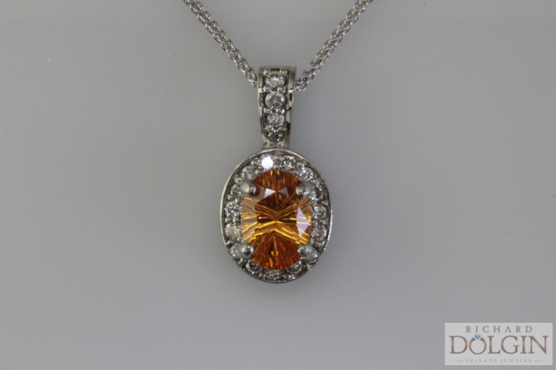 Spessartite and diamond pendant