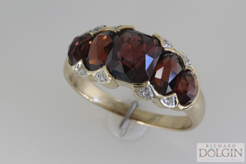 Antique yellow gold garnet ring with diamond accents