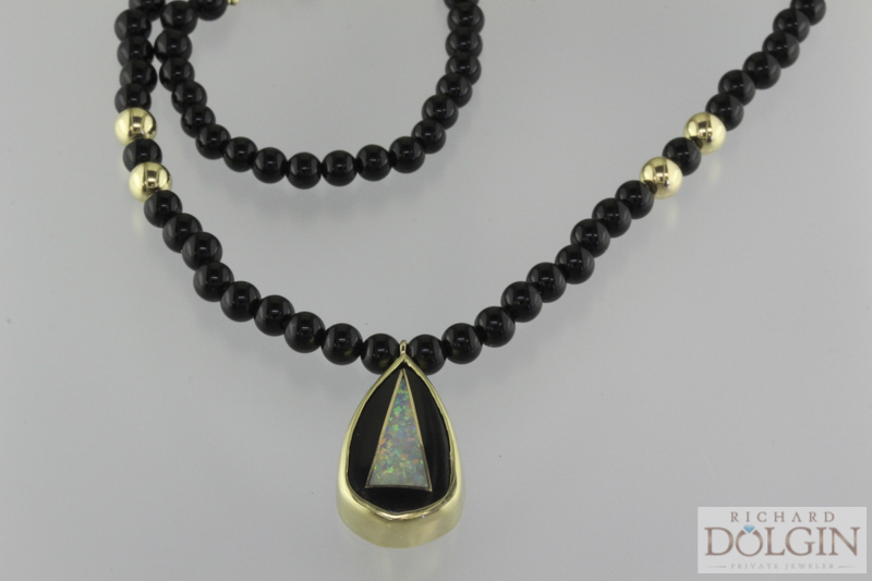 18k yellow gold, black jade and black opal pendant