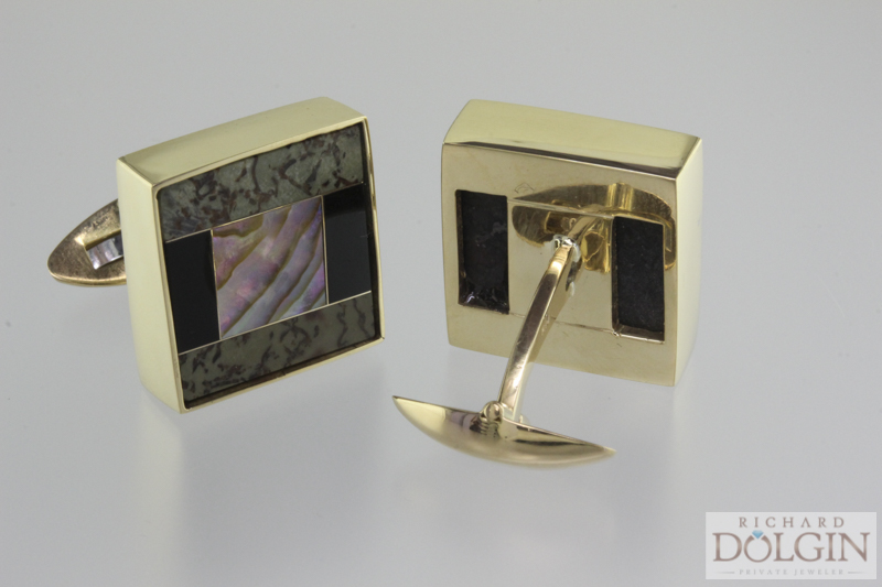 18k yellow gold, black jade, dinosaur bone and abalone cuff links