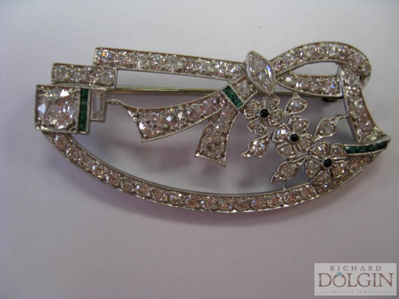 Antique platinum emerald and diamond pin