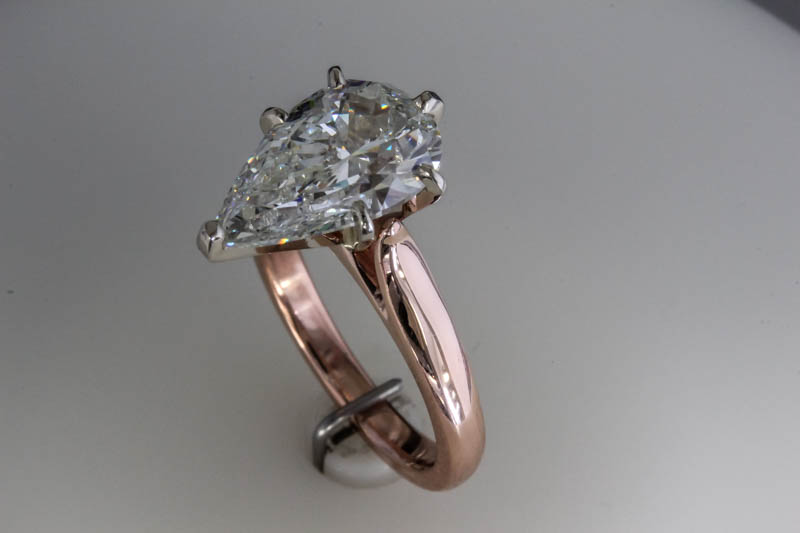 Rose gold ring with pear shaped diamond