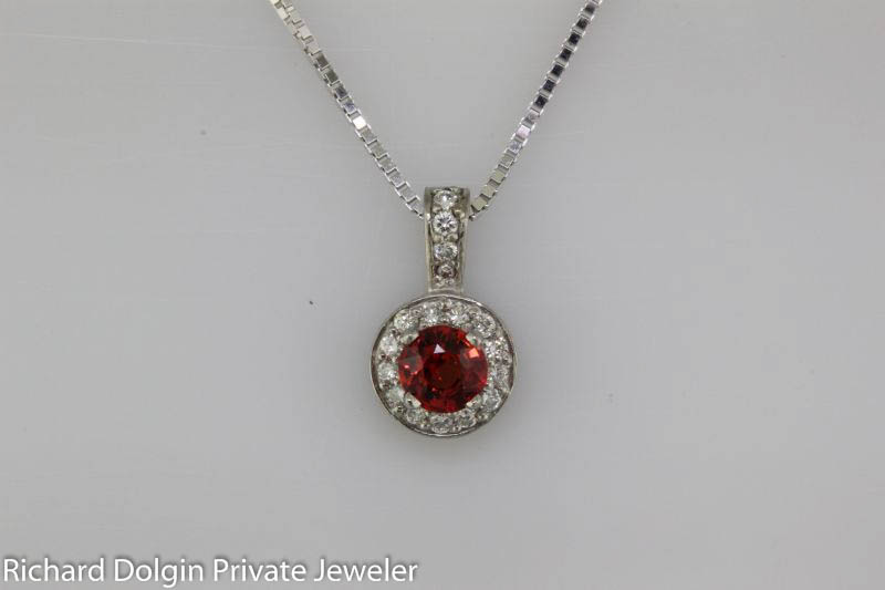 Red sapphire and diamond pendant