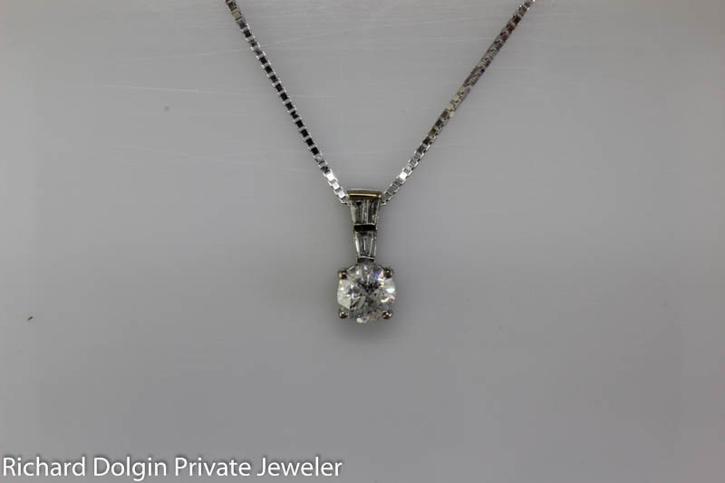 Diamond solitaire pendant set in white gold