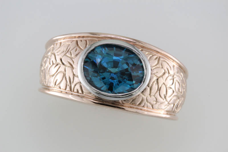 Blue zircon and rose gold band