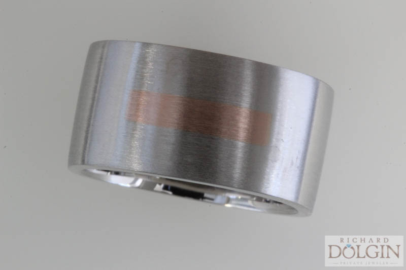 Platinum wedding band with inlaid rose gold