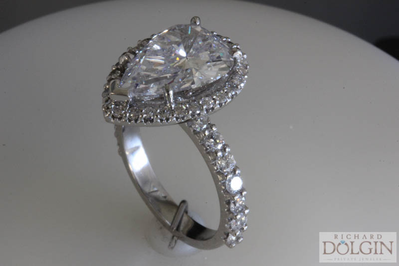Finished ring with spectacular pear shape center diamond