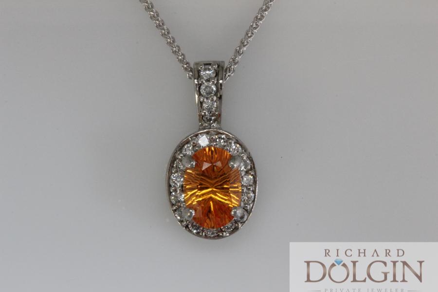 Spessartite garnet and diamond pendant