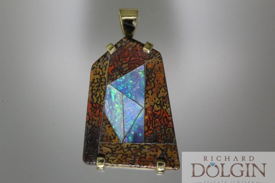 Dinosaur bone and black opal pendant