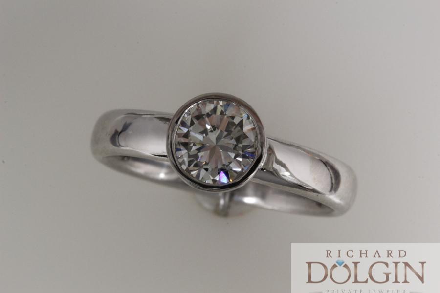 Bezel set diamond engagement ring